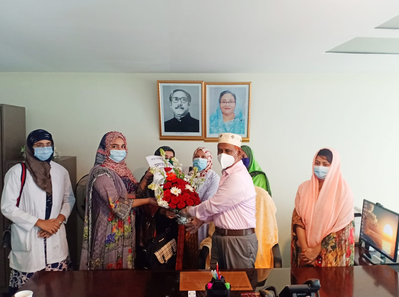 New Principal received flower bouquet from his fellow teachers