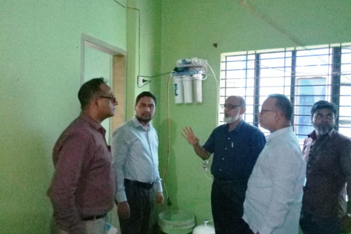 09. Honourable Directors inspect the hostel's Water Purifier with their team